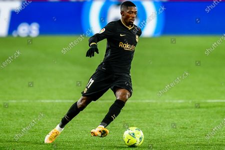 Barcelona's Ousmane Dembele runs with the ball during the Spanish La Liga soccer match between Granada and FC Barcelona at the Los Carmenes stadium in Granada, Spain