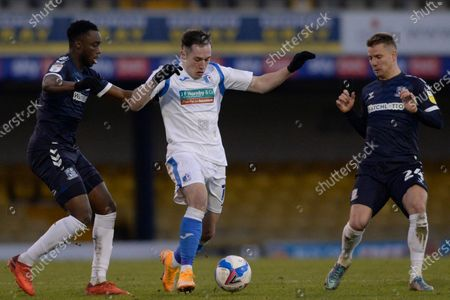 (L) James Olayinka and (R) Jason Demetriou of Southend and Josh Kay (C) of Barrow AFC in action during Sky Bet League Two match between Southend and Barrow AFC at Roots Hall in Southend, UK - 9th January 2021
