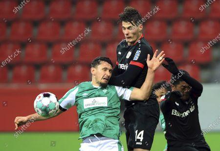 Leverkusen's Patrik Schick and Bremen's Milos Veljkovic, left, fight for the ball during the German Bundesliga soccer match between Bayer 04 Leverkusen and Werder Bremen in Leverkusen, Germany