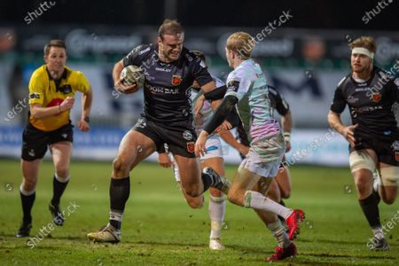Jamie Roberts of Dragons is tackled by Mat Protheroe of Ospreys