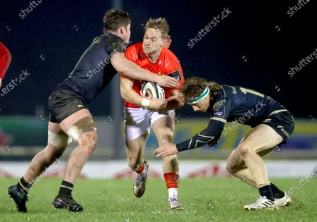 Connacht vs Munster. Munster's Mike Haley is tackled by Sean Masterson and Ben O'Donnell of Connacht