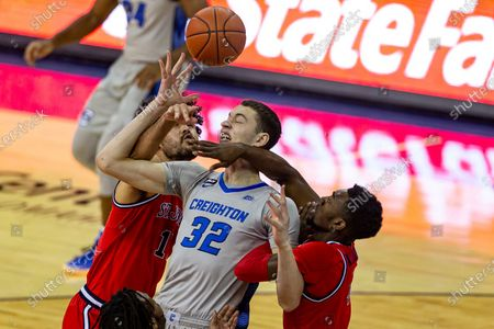 Creighton center Ryan Kalkbrenner (32) fights for a rebound against St. John's forward Josh Roberts (1) and St. John's guard Greg Williams Jr. (4) in the first half of an NCAA college basketball game, in Omaha, Neb