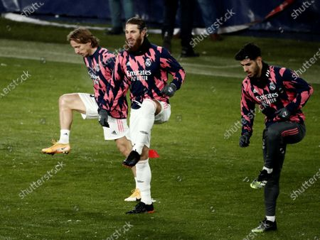 Stock Picture of (L-R) Real Madrid's midfielder Luka Modric, defender Sergio Ramos and striker Marco Asensio warm up prior to the Spanish LaLiga soccer match between CA Osasuna and Real Madrid held at El Sadar stadium in Pamplona, northern Spain, 09 January 2021.