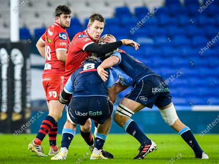 Cardiff Blues vs Scarlets. Scarlets' Liam Williams is tackled by Josh Turnbull and James Botham of Cardiff Blues