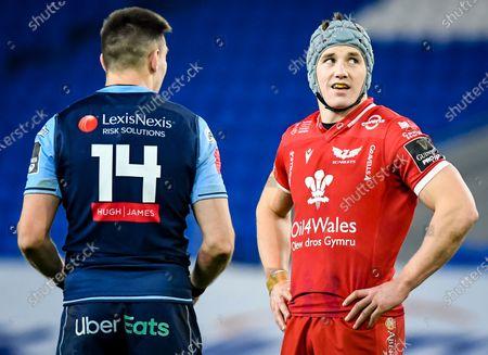 Cardiff Blues vs Scarlets. Scarlets' Jonathan Davies with Josh Adams of Cardiff Blues
