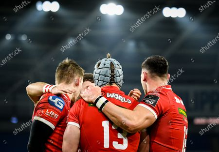 Cardiff Blues vs Scarlets. Scarlets' Liam Williams, Jonathan Davies and Johnny Williams celebrate after a try is scored