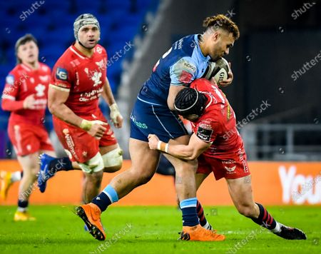 Cardiff Blues vs Scarlets. Cardiff Blues' Willis Halaholo is tackled by Leigh Halfpenny of Scarlets