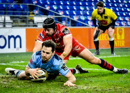 Cardiff Blues vs Scarlets. Cardiff Blues' Tomos Williams scores a try as Leigh Halfpenny of Scarlets attempts a tackle