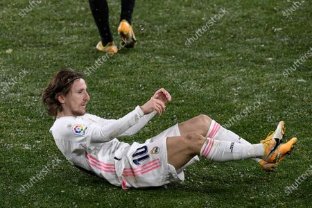Real Madrid's Luka Modric lies on the ground during a Spanish La Liga soccer match between Osasuna and Real Madrid at El Sadar stadium in Pamplona, Spain
