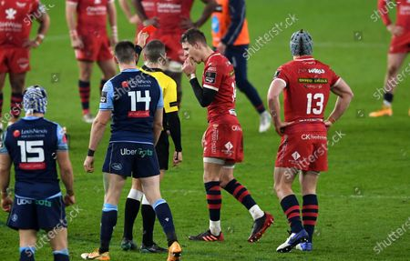 Stock Photo of Liam Williams of Scarlets is shown a red card by Referee Craig Evans.