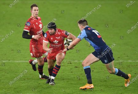 Leigh Halfpenny of Scarlets takes on Josh Adams of Cardiff Blues.
