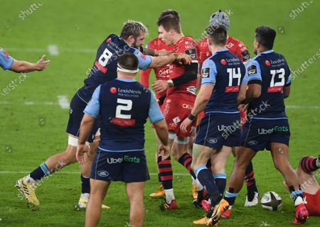 Josh Turnbull of Cardiff Blues pushes Liam Williams of Scarlets during a heated moment.