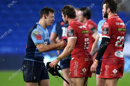 Stock Image of Jarrod Evans of Cardiff Blues and Leigh Halfpenny of Scarlets at the end of the game.
