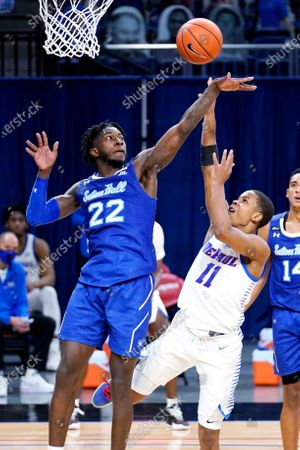 DePaul guard Charlie Moore, right, shoots over Seton Hall guard Myles Cale during the second half of an NCAA college basketball game in Chicago