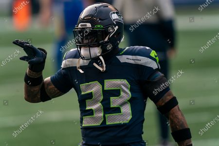 Seattle Seahawks defensive back Jamal Adams gestures during warmups before an NFL wild-card playoff football game against the Los Angeles Rams, in Seattle. The Rams won 30-20
