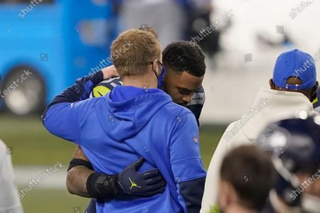Seattle Seahawks strong safety Jamal Adams, right, greets Los Angeles Rams head coach Sean McVay after an NFL wild-card playoff football game, in Seattle