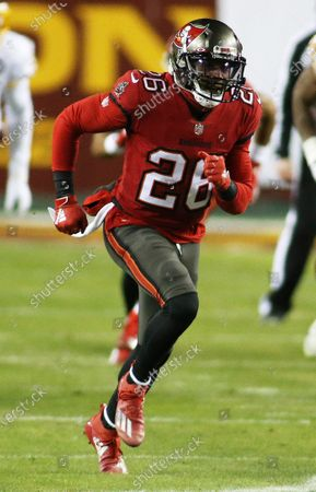 Tampa Bay Buccaneers defensive back Andrew Adams (26) in action during an NFL wild-card playoff football game against the Washington Football Team, in Landover, Md