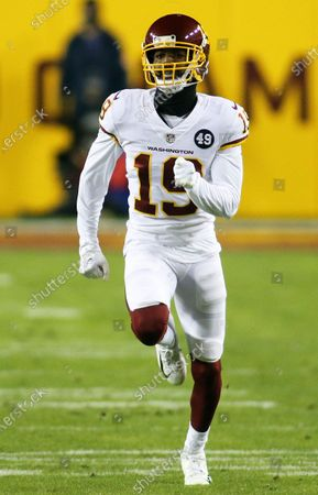 Stock Photo of Washington Football Team wide receiver Robert Foster (19) in action during an NFL wild-card playoff football game against the Tampa Bay Buccaneers, in Landover, Md