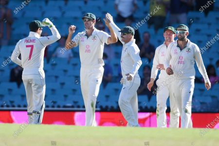 Mitchell Starc (2-L) of Australia celebrates taking the wicket of Rohit Sharma of India, caught Starc bowled Cummins for 52, during day 4 of the third Test Match between Australia and India at the SCG, Sydney, Australia, 10 January 2021.