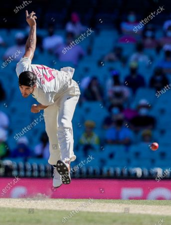 Australia's Mitchell Starc bowls during play on day four of the third cricket test between India and Australia at the Sydney Cricket Ground, Sydney, Australia