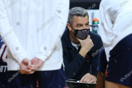 Stock Photo of Chestnut Hill, MA, USA; Virginia Cavaliers head coach Tony Bennett speaks with his team during a time-out during the NCAA basketball game between Virginia Cavaliers and Boston College Eagles at Conte Forum