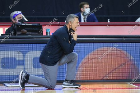 Chestnut Hill, MA, USA; Virginia Cavaliers head coach Tony Bennett instructs his team in action during the NCAA basketball game between Virginia Cavaliers and Boston College Eagles at Conte Forum