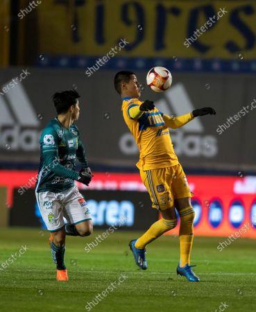 Hugo Ayala (R) of Tigres UANL in action against Victor Davila (L) of Leon, during the Liga MX Clausura Tournament soccer match between Tigres UANL and Leon at the University Stadium in San Nicolas de los Garza, Mexico, 09 January 2021.