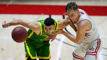 Oregon guard Chris Duarte, left, and Utah guard Pelle Larsson, right, vie for the ball during the second half of an NCAA college basketball game, in Salt Lake City