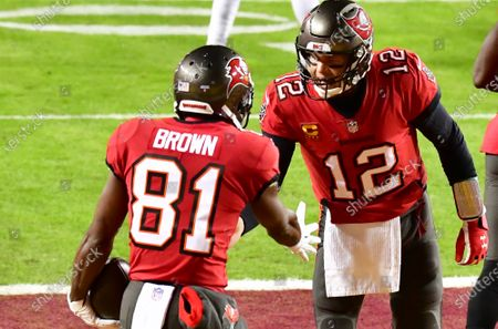 Tampa Bay Buccaneers quarterback Tom Brady (12) greets wide receiver Antonio Brown (81) after completing a pass for a 36-yard touchdown against the Washington Football Team during the first half of a wild card playoff game at FedEx Field in Landover, Maryland on Saturday, January 9, 2021.