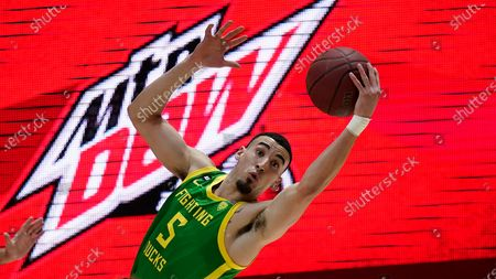 Oregon guard Chris Duarte (5) pulls down a rebound against Utah in the first half during an NCAA college basketball game, in Salt Lake City