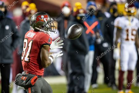 Tampa Bay Buccaneers wide receiver Antonio Brown (81) hauls in the pass and takes it into the end zone for the touchdown during the NFC Wildcard Playoff game between the Tampa Bay Buccaneers and the Washington Football Team at FedEx Field in Landover, Maryland Photographer: Cory Royster
