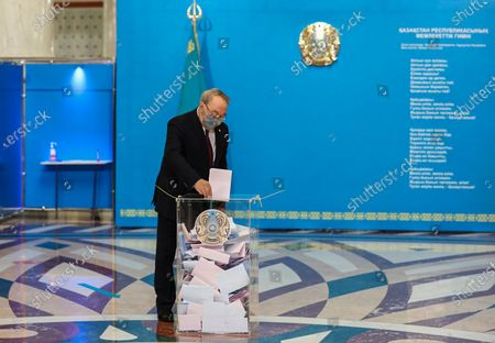 Stock Photo of Kazakhstan's former president and the head of the Nur-Otan party Nursultan Nazarbayev casts his ballot at a polling station during the Kazakhstan's legislative elections to elect the members of Majilis (lower house of the parliament) in Nur-Sultan, the capital city of Kazakhstan, 10 January 2021. Majilis has 107 seats and his members elect to five-year terms.