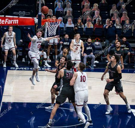 Moraga, CA U.S.A. St. Mary's Gaels guard Logan Johnson (0) drives to the hoop and scores during the NCAA Men's Basketball game between Santa Clara Broncos and the Saint Mary's Gaels 62-64 lost at McKeon Pavilion Moraga Calif. Thurman James / CSM