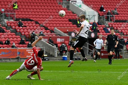 Michael Jacobs (24) of Portsmouth heads a shot at goal during the The FA Cup match between Bristol City and Portsmouth at Ashton Gate, Bristol