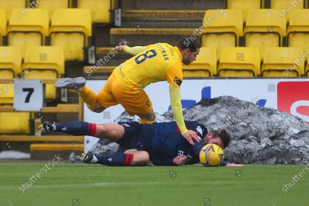 Stock Photo of Jason Naismith of Ross County feels pressure from Scott Pittman of Livingston during the Scottish Premiership match between Livingston and Ross County at Tony Macaroni Arena, Livingston