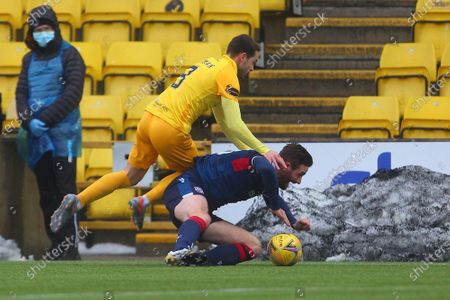 Jason Naismith of Ross County feels pressure from Scott Pittman of Livingston during the Scottish Premiership match between Livingston and Ross County at Tony Macaroni Arena, Livingston