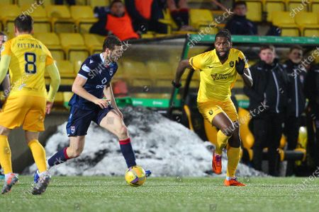 Alex Iacovitti of Ross County feels pressure from Jay Emmanuel-Thomas of Livingston during the Scottish Premiership match between Livingston and Ross County at Tony Macaroni Arena, Livingston
