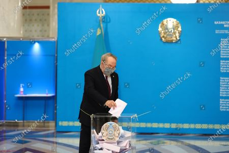 Stock Image of Kazakhstan's First President Nursultan Nazarbayev casts his ballot during a parliamentary election in Nur-Sultan, Kazakhstan, Jan. 10, 2021. Kazakh voters headed to parliamentary polls on Sunday, with five political parties vying for seats in the Majilis, or the lower chamber of the parliament.