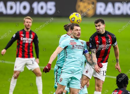 Alessio Romagnoli of AC Milan and Andrea Belotti of Torino FC are seen in action during the Serie A 2020/21 football match between AC Milan and Torino FC at the San Siro Stadium in Milan. (Final score; AC Milan 2:0 Torino FC)