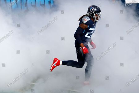 Tennessee Titans running back Derrick Henry (22) is introduced before an NFL wild-card playoff football game between the Titans and the Baltimore Ravens, in Nashville, Tenn