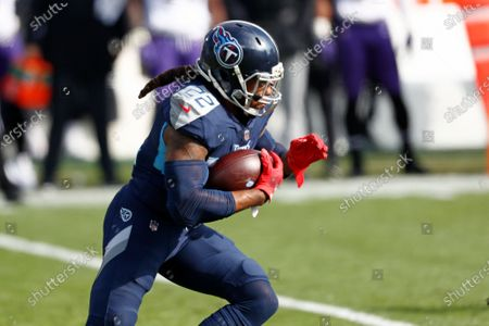 Tennessee Titans running back Derrick Henry (22) carries the ball against the Baltimore Ravens in the first half of an NFL wild-card playoff football game, in Nashville, Tenn