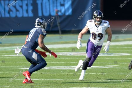 Stock Image of Baltimore Ravens tight end Mark Andrews (89) is defended by Tennessee Titans free safety Kevin Byard (31) in the first half of an NFL wild-card playoff football game, in Nashville, Tenn
