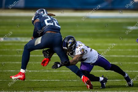 Baltimore Ravens free safety DeShon Elliott (32) tackles Tennessee Titans running back Derrick Henry (22) during the third quarter an NFL wild-card playoff football game, in Nashville, Tenn. Ravens defeat Titans 20-13