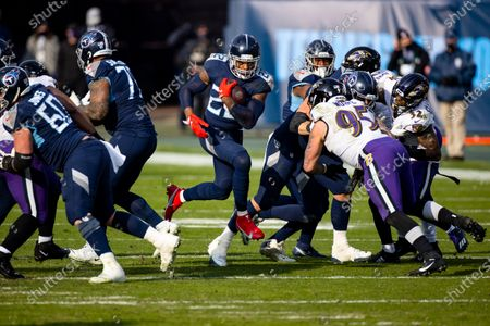 Tennessee Titans running back Derrick Henry (22) runs with the ball against the Baltimore Ravens during the fourth quarter an NFL wild-card playoff football game, in Nashville, Tenn. Ravens defeat Titans 20-13