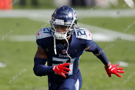 Tennessee Titans cornerback Malcolm Butler (21) warms up before an NFL wild-card playoff football game against the Baltimore Ravens, in Nashville, Tenn