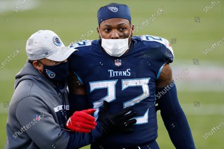 Stock Photo of Tennessee Titans running back Derrick Henry (22) leaves the field after the Titans lost to the Baltimore Ravens in an NFL wild-card playoff football game, in Nashville, Tenn. The Ravens won 20-13