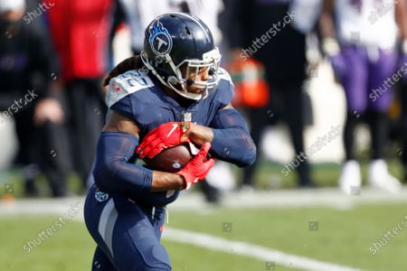 Tennessee Titans running back Derrick Henry carries the ball against the Baltimore Ravens in the first half of an NFL wild-card playoff football game, in Nashville, Tenn