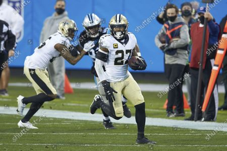 New Orleans Saints safety Malcolm Jenkins (27) returns a interception during an NFL football game against the Carolina Panthers, in Charlotte, N.C