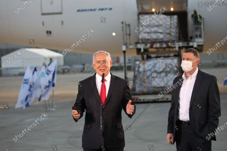 Israel Prime Minister Benjamin Netanyahu (L) and Health Minister Yuli-Yoel Edelstein attend the arrival of a shipment of the Pfizer Coronavirus vaccines, at Ben Gurion Airport.