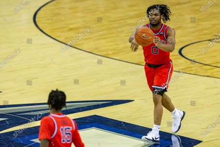 St. John's guard Posh Alexander (0) makes a pass to St. John's guard Vince Cole (15) against Creighton in the first half during an NCAA college basketball game, in Omaha, Neb